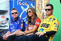 Feb 7, 2014; Pomona, CA, USA; NHRA top fuel dragster driver Leah Pritchett (center) sits between funny car driver Tommy Johnson Jr (left) and pro stock driver Jeg Coughlin Jr during qualifying for the Winternationals at Auto Club Raceway at Pomona. Mandatory Credit: Mark J. Rebilas-