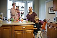 Kelli Evans, Emma Karen Wade, Evan,  and Grady, together for 17 years, Durham, NC.