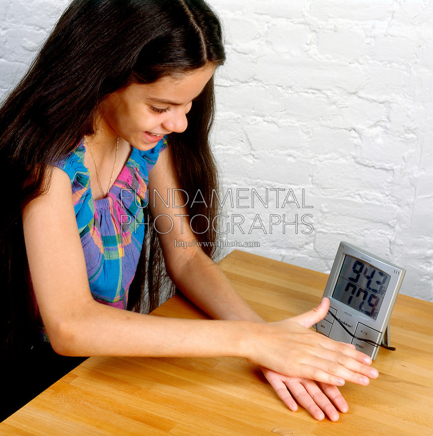 MEASURING HEAT CAUSED BY FRICTION [1 of 2]<br /> (Variations Available)<br /> Using Indoor Outdoor Thermometer Sensor<br /> By taping the sensor of an indoor/outdoor themometer to her hand a student can measure the amount of heat generated by rubbing her hand together.
