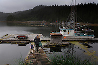 Cindy Wyatt and her family walk back to the boat they live on when they are fishing. They were visiting her parents on remote Kosciusko Island.  They live on nearby Marble Island when they are not fishing for salmon.