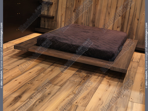 Stylish contemporary bedroom with wooden walls and floor. Interior design display