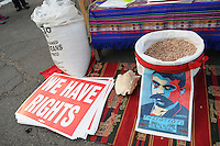 "Phoenix, Arizona. September 22, 2012 - Strong Mexican and Native-American symbolism was on display during the ""Festival of Resistance"" rally. A sack of pinto beans, a poster with the likeness of Mexican revolutionary hero Emiliano Zapata and a ""We Have Rights"" poster oppose SB 1070. Photo by Eduardo Barraza © 2012"