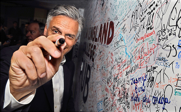 Henniker, New Hampshire: September 13, 2011<br /> Presidential candidate Jon Huntsman Jr. smiles after signing an autograph wall during a campaign stop at New England College. &copy;Chris Fitzgerald / Candidate Photos