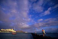 Waikiki - Surfers on wall at sunset