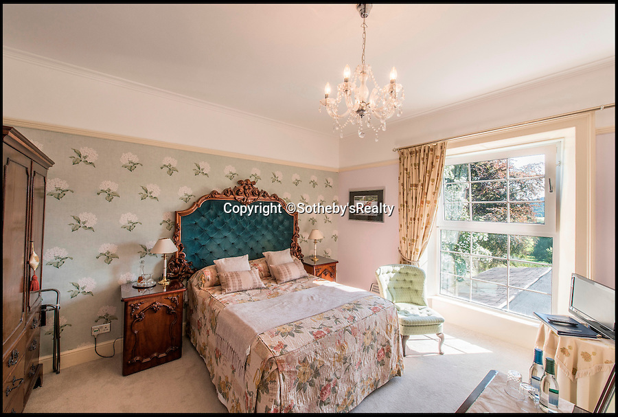 BNPS.co.uk (01202 558833)<br /> Pic: Sotheby'sRealty/BNPS<br /> <br /> One of the bedrooms.<br /> <br /> The holiday home that inspired a young Beatrix Potter to draw and paint wild animals has gone on the market for &pound;1.25m.<br /> <br /> Ees Wyke is a magnificent country house that was rented by the childrens author's London-based parents in the summer holidays.<br /> <br /> It was said a teenage Beatrix used the Lake District scenery surrounding the Georgian property to indulge her interest in exploring and drawing wildlife.