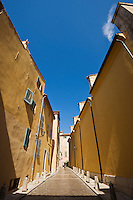 Narrow walkway between buildings, Saint Tropez, France