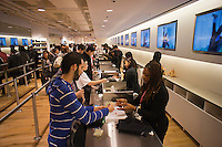 Customers at the cashier at the grand opening of the Uniqlo Flagship store on Fifth Avenue in New York on Friday, October 14, 2011.  The store is a staggering 89,000 square feet on multiple levels and is Fast Retailing's second store in the United States with a third opening next week in the Herald Square shopping district. The largest store on Fifth Avenue filled to the brim with affordable clothing it competes with stalwarts such as the Gap and Zara which are in the immediate proximity. Fast Retailing plans on opening 200 to 300 stores worldwide until 2020 and currently has 1000 stores. (© Richard B. Levine)