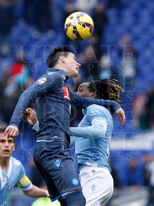 Calcio, Serie A: Lazio vs Napoli. Roma, stadio Olimpico, 18 gennaio 2015.<br /> Napoli&rsquo;s Jose' Maria Callejon and Lazio&rsquo;s Luis Pedro Cavanda, right, jump for the ball during the Italian Serie A football match between Lazio and Napoli at Rome's Olympic stadium, 18 January 2015.<br /> UPDATE IMAGES PRESS/Isabella Bonotto
