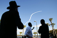 Orthodox Jews Nachman Segal, Dov Kok, and Neftaly Hertzel watch as Space Shuttle Columbia blasts off on the STS 107 mission. carrying the first Israeli astronaut , Ilan Ramon and a crew of seven (including Rick Husband, Willie McCool, Michael Anderson, Kalpana Chawla, David Brown, and Laurel Clark) into orbit, Cocoa Beach, FL, January 16, 2003. The mission ended tragically as the Space Shuttle disintegrated during its terun to Earth in February 2003.  (Photo by Brian Cleary/www.bcpix.com)