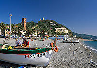 Italy, Liguria, Italian Riviera, Noli: resort at the Golfo di Genova, fishermen repairing their nets