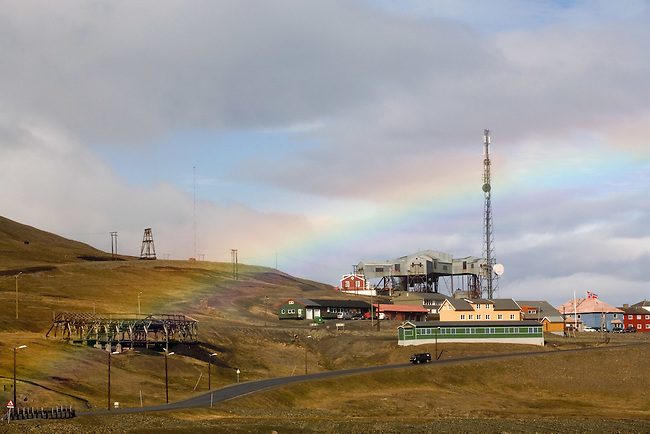 Taubanesentralen, the funicular centre for the coal, Skjaeringa, with a rainbow in Longyearbyen. Spitsbergen.