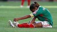 Wolfsburg , 270611 , FIFA / Frauen Weltmeisterschaft 2011 / Womens Worldcup 2011 , Gruppe B  ,  ..England - Mexico ..Maribel Dominguez (Mexico) mit Krampf am Boden ..Foto:Karina Hessland ..