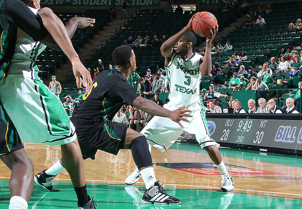 DENTON, TX - DECEMBER 16: Brandon Fortenberry #5 of the Southeastern Louisiana Lions guards Alzee Williams #3 of the North Texas Mean Green at the UNT Coliseum on December 16, 2012 in Denton, Texas. (Photo by Rick Yeatts/Getty Images)