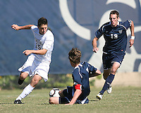Gabe Padilla #25 of Georgetwn University is slide tackled by Kyle McCarthy #7 of Villanova University during a Big East match at North Kehoe Field, Georgetown University on October16 2010 in Washington D.C. Georgetown won 3-1.