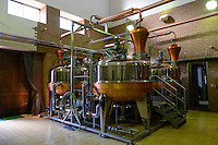 Grappa stills. Sata Souji Shoten Shochu Distillery, Minami Kyushu, Kagoshima Pref, Japan, December 21, 2016. The Sata Souji Shoten Shochu Distillery makes shochu spirits from local sweet potatoes. In recent years the distillery has imported grappa, brandy, calvados stills from Europe to experiment with new distilling techniques. They have attracted considerable attention from the media and other distillers as leading innovators in their industry.