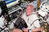 United States Senator John H. Glenn Jr. (Democrat of Ohio), payload specialist, works with the Advanced Organic Separation (ADSEP) experiment inside the Spacehab facility onboard Discovery from October 29 - November 7, 1998. Sen. Glenn joined five astronauts and a Japanese payload specialist for the nine-day STS-95 mission in Earth orbit..Credit: NASA via CNP