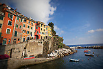 Photo of colorful cliffside buildings in Riomaggiore, Italy.