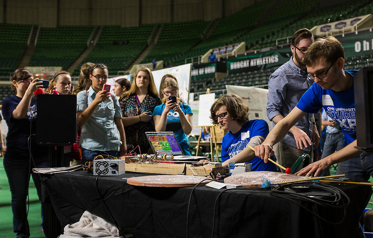Senior music majors Jake Schlaerth, left, and Turner Matthews demonstrate the homemade musical instrument they created during the Ohio University Student Expo on Thursday, April 10, 2015.   Photo by Ohio University / Rob Hardin