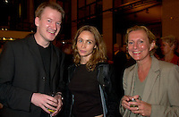 French actress Emanuelle Beart(M)  who is the President of the 25th  World Film Festival's  Jury  for a photo  with two unidentified guests (L &amp; R)  at  the Party of the German Delegation , August 26th, 2001<br /> in Montreal, CANADA<br /> <br /> Brought up on a farm in Provence because her father, French singer and poet Guy B&Egrave;art didn't want her to be affected by the glamour world of Paris showbusiness, Emmanuelle B&Egrave;art nevertheless got the acting urge in early adolescence. At age 15, after a couple of bit parts, she came to Montreal as an au pair to learn English. Back in France, after acting lessons and few small roles in television, she made her big-screen breakthrough in the title role of Claude Berri's Pagnol adaptation, MANON OF THE SPRING (1986). A year later she made her Hollywood debut in Tom McLoughlin's DATE WITH AN ANGEL. She has since played for some of the premier directors on both sides of the Atlantic: Rivette (LA BELLE NOISEUSE, 1991), Sautet (NELLY AND MR. ARNAUD (1995), Chabrol (L'ENFER,1994), De Palma (MISSION: IMPOSSIBLE, 1996) and Ruiz (TIME REGAINED, 1999). She stars in Catherine Corsini's REPLAY, showing at this year's Festival.<br /> <br /> Photo by Pierre Roussel / Getty Images (On Spec)<br /> <br /> NOTE : Nikon D-1 JPEG opened with QUIMAGE ICC profile , saved as Adobe RG 1998 color space.
