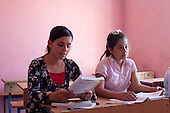 DOMIZ, IRAQ: Children attend classes in a makeshift school in the Domiz refugee camp...Over 7,000 Syrian Kurds have fled the violence in Syria and are living in the Domiz refugee camp in the semi-autonomous region of Iraqi Kurdistan...Photo by Ali Arkady/Metrography