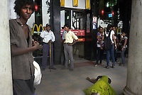 beggars outside McDonalds, Connaught Place, Central Delhi
