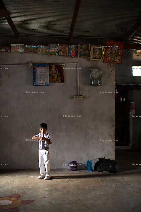 Hemant Jat, 6, waits eagerly for his school bus at home in Maheshwar, Khargone, Madhya Pradesh, India on 13 November 2014. Hemant, the son of a Fairtrade cotton farmer, wants to be a police man when he grows up and gets a 5% discount of school fees at the Vasudha school. His father Nandaram would be happy if Hemant took over the farm but if he does well in school, he could look for other careers. Photo by Suzanne Lee for Fairtrade