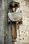 Gothic statues holding a sundial from the Cathedral of Chartres, France. . A UNESCO World Heritage Site.