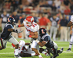 Fresno State's A.J. Ellis (23) is tackled by Ole Miss linebacker Jonathan Cornell (51) at Vaught-Hemingway Stadium in Oxford, Miss. on Saturday, September 25, 2010. Ole Miss won 55-38.