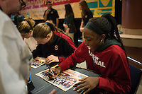 NASHVILLE, TN - The Stanford Cardinal greet fans during an autograph session in Nashville, TN for the 2014 NCAA Final Four tournament at the Bridgestone Arena.