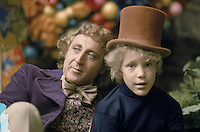 WILLY WONKA AND THE CHOCOLATE FACTORY--Based on the children's classic by Roald Dahl, &quot;poor but honest&quot; young Charlie wins a tour of Willy Wonka's factory, filled with a chocolate river and waterfall, marshmallow stuffed mushrooms and constant surprises. <br /> GENE WILDER as Willy Wonka, PETER OSTRUM as Charlie Bucket<br /> Filmstill - Editorial Use only<br /> Supplied by Capital Pictures / MediaPunch<br /> www.capitalpictures.com