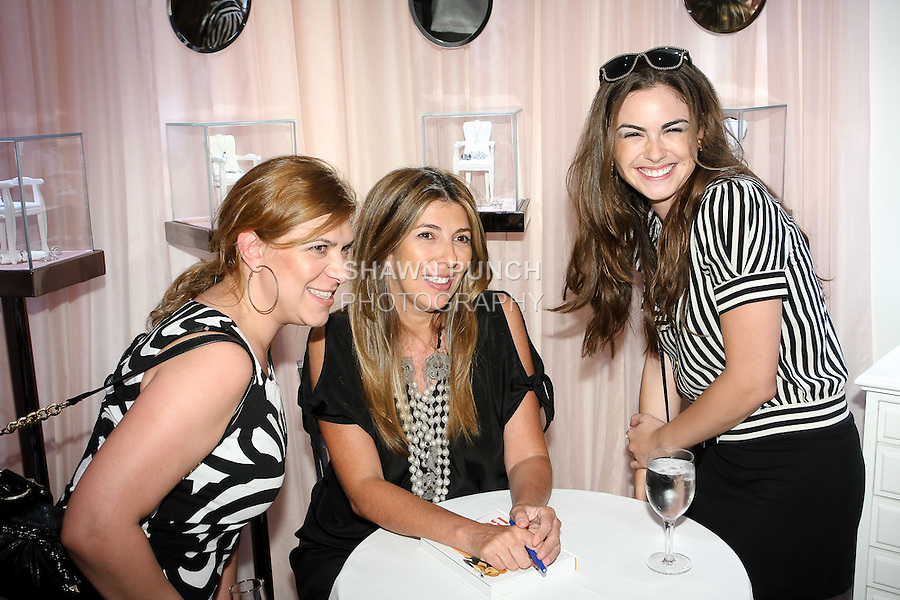 Nina Garcia poses with fans during Nina Garcia's &quot;Look Book: What To Wear For Every Occasion&quot;, book release party with Marie Claire at Tous Rockefeller Center, August 17, 2010.