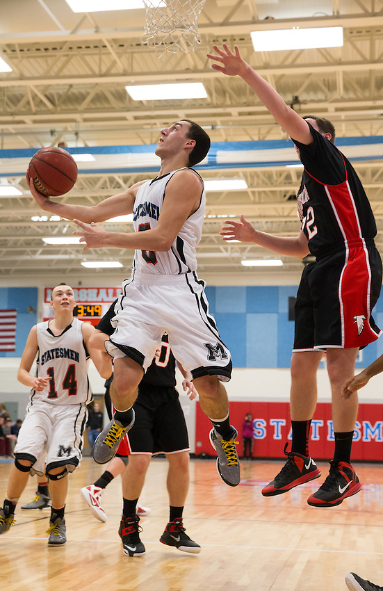 Marshall Statesmen defeated the Madison High School Warhawks 53-36 in a Liberty District rivalry boys basketball game January 28, 2013 at George C. Marshall High School.