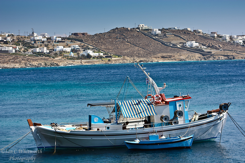 fishing boat at anchor off the shore of Mykonos in the Greek Islands