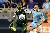 Jorge Perlaza (15) forward Portland Timbers controls the ball watched by Matt Besler Sporting KC... Sporting Kansas City defeated Portland Timbers 3-1 at LIVESTRONG Sporting Park, Kansas City, Kansas.
