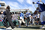 30 November 2013: Duke head coach David Cutcliffe and Johndre Bennett (12) lead the rest of the team onto the field. The University of North Carolina Tar Heels played the Duke University Blue Devils at Keenan Memorial Stadium in Chapel Hill, NC in a 2013 NCAA Division I Football game. Duke won the game 27-25.