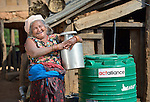 Tika Maya Pulami holds a water pot as she fetches water from a cistern in Salang, a village in the Dhading District of Nepal where Dan Church Aid, a member of the ACT Alliance, has provided a variety of support to local villagers in the wake of a devastating 2015 earthquake. The village's water system was destroyed by the quake, forcing women to walk two hours or more to a nearby river to fetch water. Working with a local organization, the Forum for Awareness and Youth Activity, the ACT Alliance rebuilt the village's water system.