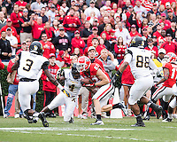 The Georgia Bulldogs beat the App State Mountaineers 45-6 in their homecoming game.  After a close first half, UGA scored 31 unanswered points in the second half.  Georgia Bulldogs wide receiver Michael Bennett (82), Appalachian State Mountaineers defensive back Rodger Walker (4), Appalachian State Mountaineers wide receiver Jaquil Capel (88), Appalachian State Mountaineers defensive back Alex Gray (3)