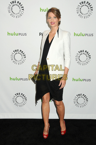 "Stana Katic.PaleyFest 2012 Presents ""Castle"" held at The Saban Theatre, Beverly Hills, California, USA, 9th March 2012..full length jacket white dress black red peep toe patent shoes .CAP/ADM/BP.©Byron Purvis/AdMedia/Capital Pictures."