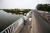 Lancut, Poland, August 5, 2009:.Fourth stage of Tour de Pologne. Racers crossing Wislok river..The 66th Tour de Pologne UCI Pro Tour found its way on to the global calendar of the International Cycling Union, joining the list of the most important races including Tour de France and Giro d' Italia. Piotr Malecki accompanied the cyclists on this tiresome tour, fighting sharp curves and uphill rides. But it was not the race itself that became the main character of his photographs, but the people who gathered by the road since early morning, often taking brake from work, to cheer the cyclists on their quest. .(Photo by Piotr Malecki / Napo Images)..Okolice Lancuta, most na rzece Wislok, Czwarty etap wyscigu Tour de Pologne..Sierpien 2009.Fot: Piotr Malecki / Napo Images