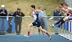 1665<br /> <br /> Eagle River&rsquo;s Mason Wadsworth leads his 110 high hurdles preliminary heat on Friday.  Photo for the Star by Michael DInneen