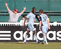 Ike Opara (3) of Sporting Kansas City celebrates his goal with teammate Jacob Peterson (37) during a Major League Soccer match at RFK Stadium in Washington, DC.  D.C. United tied Sporting Kansas City, 1-1.
