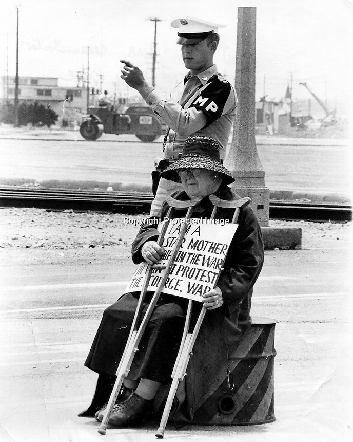 Gold Star Mother protesting the Viet Nam War sitting .in front of the Alameda Naval Air Station in Alameda, Ca 1964 (photo by Ron Riesterer)