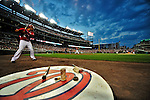9 July 2011: Washington Nationals infielder Ian Desmond stands on deck with Jesus Flores at bat against the Colorado Rockies at Nationals Park in Washington, District of Columbia. The Nationals were edged out by the Rockies 2-1, dropping the second game of their 3-game series. Mandatory Credit: Ed Wolfstein Photo