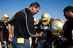 """George Visger, 51, of Grass Valley, Ca., talks to a Staggs High football players about his Orange Bowl and Super Bowl rings, during practice, in Stockton, Ca., on Friday, Oct. 9, 2009. Visger has severe short-term memory loss due to multiple head injuries, however retains a better long-term memory. Visger says there are years that really don't exist. """"I don't really remember them happening."""" Visger survived 9 brain surgeries, caused by concussions incurred throughout his playing career. His first one in 1981, when he turned 23 years old. He keeps daily notes in a yellow notebook and has about three boxes full of notebooks that date back to 1990. ..He works with the Coaches Concussion Clinic, the Brain Injury Association and the Hydrocephaleus Association to increase awareness of concussion-related injuries. ..Visger was a scholarship player for the University of Colorado Buffalos on the 1977 Orange Bowl team, and a 1980 6th round draft pick who played for the San Francisco 49ers, earning a Super Bowl ring for the 1981 Super Bowl Championship."""