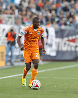 Houston Dynamo midfielder Boniek Garcia (27) looks to pass. In a Major League Soccer (MLS) match, the New England Revolution (blue/white) defeated Houston Dynamo (orange), 2-0, at Gillette Stadium on April 12, 2014.
