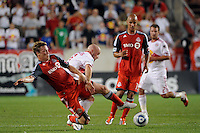 Ty Harden (20) of Toronto FC tackles the ball way from Luke Rodgers (9) of the New York Red Bulls. The New York Red Bulls defeated Toronto FC 5-0 during a Major League Soccer (MLS) match at Red Bull Arena in Harrison, NJ, on July 06, 2011.