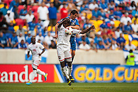 Trinidad and Tobago midfielder Keon Daniel (19) goes up for a header with El Salvador midfielder Jaime Alas (16) during a CONCACAF Gold Cup group B match at Red Bull Arena in Harrison, NJ, on July 8, 2013.