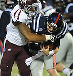 Mississippi quarterback Bo Wallace (14) is tackled by Texas A&amp;M defensive lineman Damontre Moore (94) in Oxford, Miss. on Saturday, October 6, 2012. (AP Photo/Oxford Eagle, Bruce Newman)..