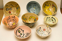Ceramic pottery, bowls, cups, plates, with dog and cat drawings for 2017 Holiday Sale by Frances M. Roberts. (© Frances M. Roberts)