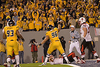 WVU defensive lineman Kellen Dykes celebrates his sack of Louisville quarterback Brian Brohm.  The West Virginia Mountaineers defeated the Louisville Cardinals 38-31 on November 08, 2007 at Mountaineer Field, Morgantown, West Virginia. .